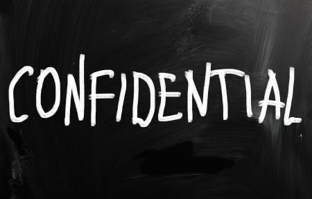 Confidential handwritten with white chalk on a blackboard photo