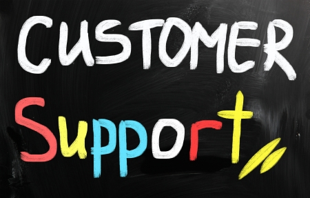customer care: Customer support handwritten with white chalk on a blackboard