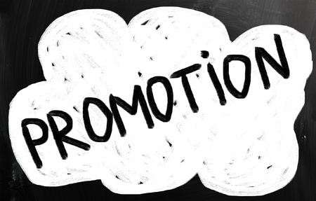 'promotion' handwritten with white chalk on a blackboard photo