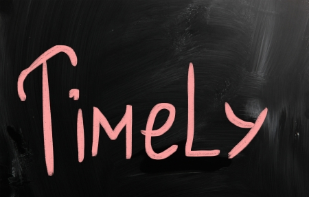 timely: Timely handwritten with white chalk on a blackboard