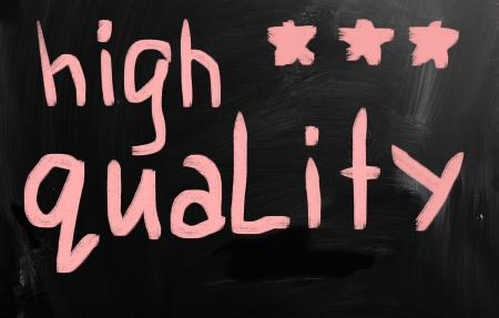 'High quality' handwritten with white chalk on a blackboard photo