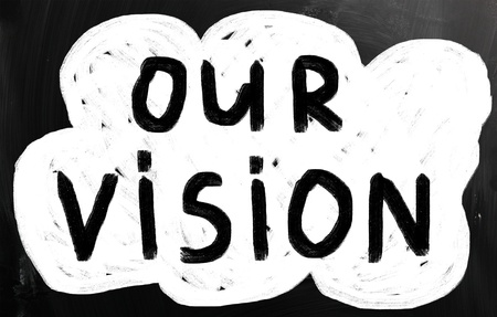 our vision: Our vision handwritten with white chalk on a blackboard Stock Photo