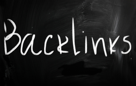 backlink: The word Backlinks handwritten with white chalk on a blackboard