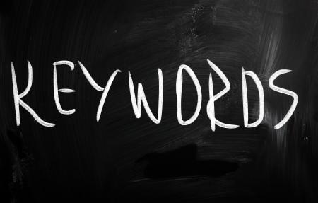 meta: Keywords handwritten with white chalk on a blackboard Stock Photo
