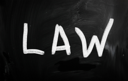 The word 'Law' handwritten with white chalk on a blackboard photo