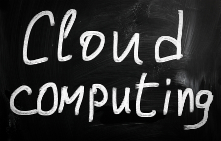 Cloud computing handwritten with white chalk on a blackboard photo