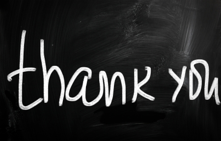 'Thank you' handwritten with white chalk on a blackboard photo