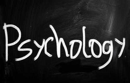 Psychology handwritten with white chalk on a blackboard photo