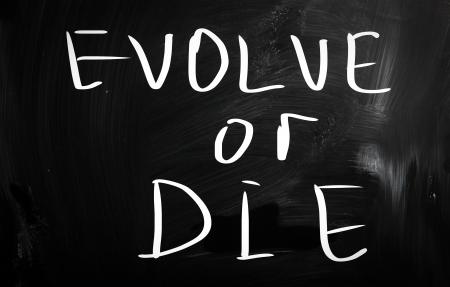 evoluer: ?oluer ou mourir Banque d'images