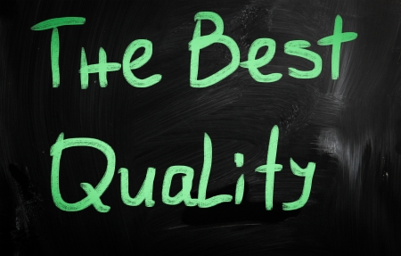 'The best quality' handwritten with white chalk on a blackboard photo