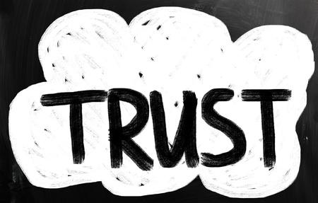 trust written with chalk on blackboard. photo