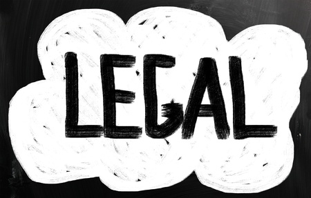 lawful: The word Legal handwritten with white chalk on a blackboard. Stock Photo