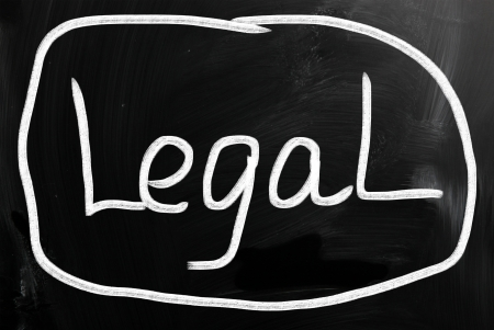 The word Legal handwritten with white chalk on a blackboard. photo