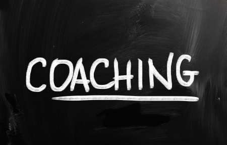 career coach: Coaching handwritten with chalk on a blackboard. Stock Photo