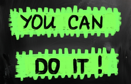 'You can do it' handwritten with chalk on a blackboard. photo