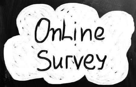 online survey: Online survey handwritten with chalk on a blackboard