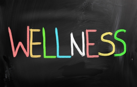 wellness: Health concept handwritten with chalk on a blackboard Stock Photo