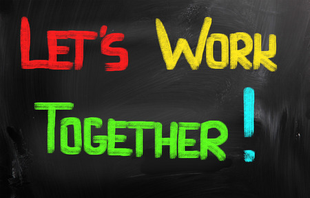 Lets Work Together words on blackboard photo