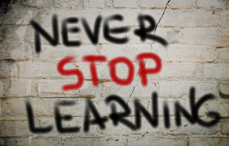 Never Stop Learning words on wall photo