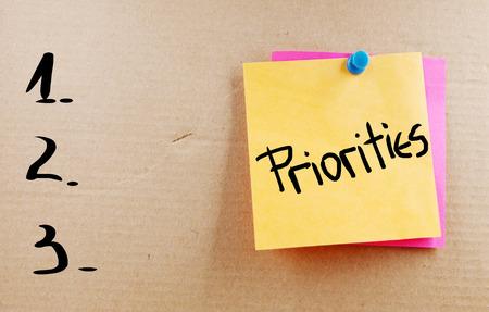 Prioriteiten woord Stockfoto