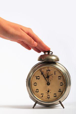 alarm clock disturbing a sleeping woman    photo