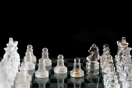 glass chess pieces on a black background Stock Photo