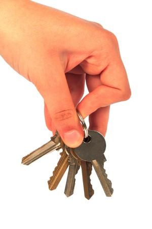 hand holding keys on a white background Stock Photo