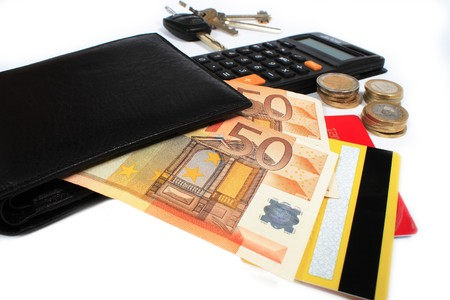 wallet and money on a white background