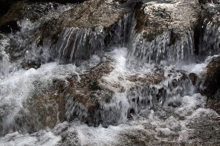 waterfall stream on mountain river close-up Stock Photo