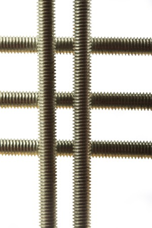 Array of long screws on a white background
