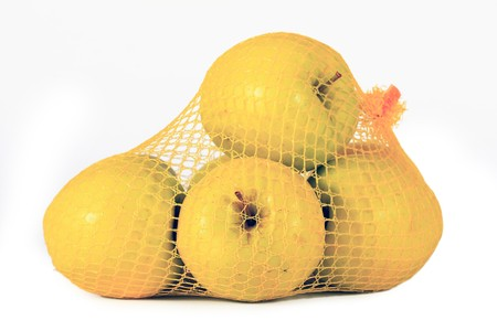 yellow apples in network on white background
