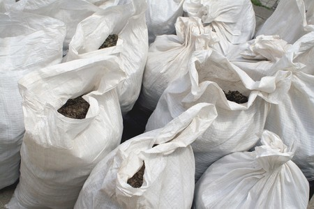 white bags of fertilizer in close-up