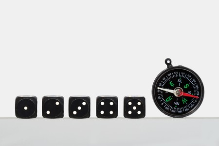 Dice and compass on a white background