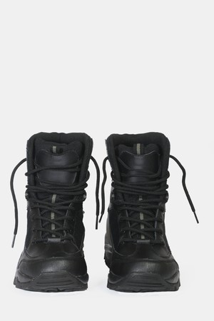 black hiking boots on a white background Stock Photo