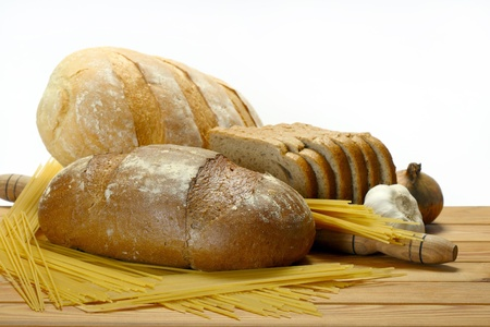 assortment of baked bread on a wooden table on a white background