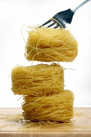 Vermicelli pasta nests on white background Stock Photo