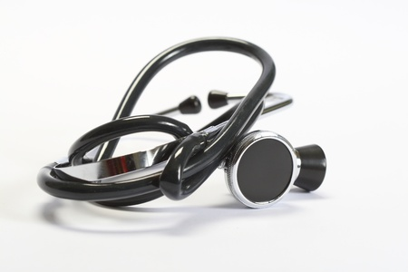 Medical stethoscope on a white background.
