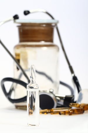 ampoules of drugs on a white background and medical supplies