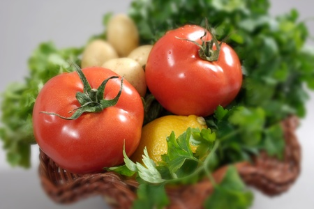 Tomatoes in a basket on a gray background-shallow dof