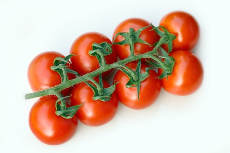 fresh cherry tomatoes on white close-up