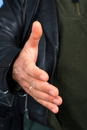 The man extend his hand to shake, close up Stock Photo