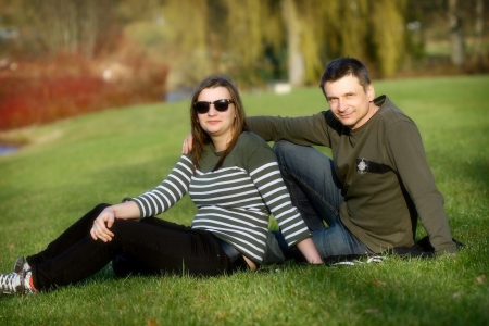 The father and the daughter together  on a grass