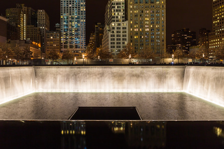 New York City, USA - December 26, 2013 -  World Trade Center Memorial Fountain on site at Ground Zero,  at night