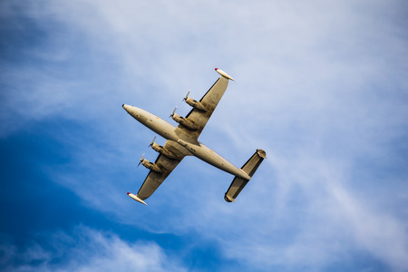 undercarriage: Undercarriage of Superconstellation aircraft, military, during fly-over Stock Photo