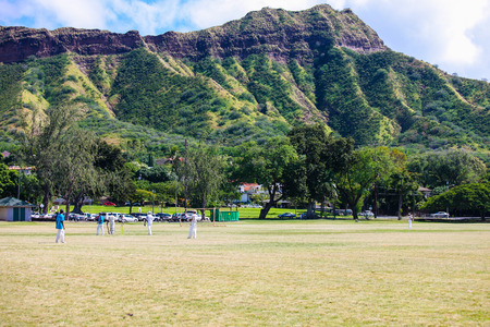 cricket game: Oahu, Hawaii, USA - February 9, 2009   local cricket game under Diamond Head crater