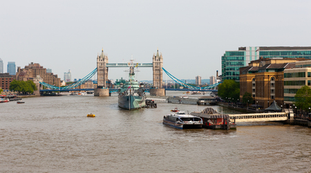 Shipping and tourist attractions on River Thames, London, England