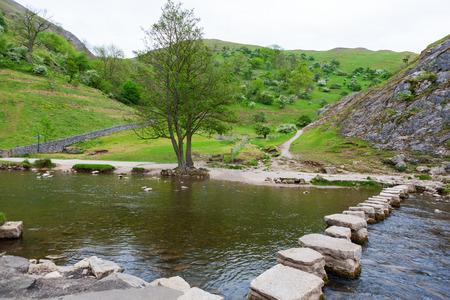 Dovedale Stepping Stones across River Dove, Peak District National Park, Derbyshire, England