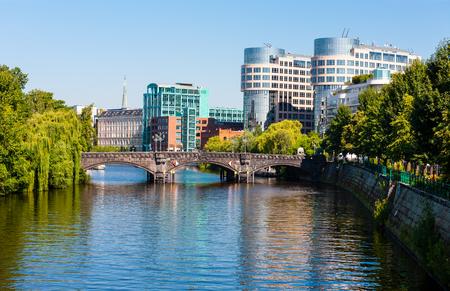 Berlin cityscape beyond Spree River, Germany
