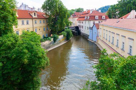 Certovka canal running through local neighbourhood of Prague, Czech Republic 写真素材