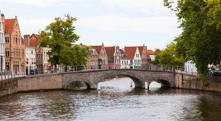 Stone bridge across Langerei Canal, Brugge, Bruges, Belgium